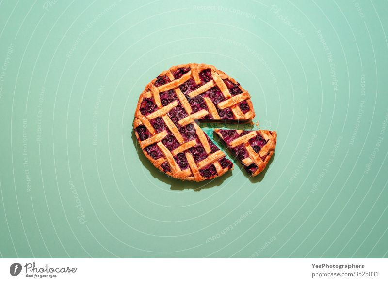 Blueberries pie with lattice crust top view on a green background. american food baked bakery bilberry blueberries blueberry pie cake canadian cuisine christmas
