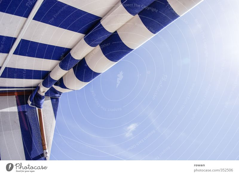 Relax Cloudless sky Warmth Sunlight Sunbeam Beach chair Stripe Striped Blue North Sea East Frisland Relaxation Beach vacation Vacation & Travel Colour photo
