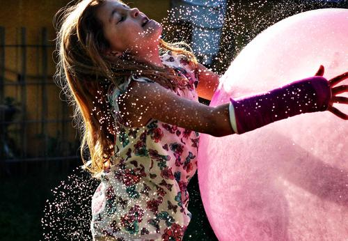 Captured the Moon Part II. Sun Sunlight Summer Summer vacation Water Inject Drops of water fun Joy girl Ball Balloon Catch arm Broken Gypsum Pink