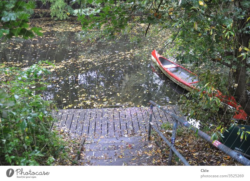Lonely landing stage with canoe Canoe Water Lake Calm Watercraft Nature Sky Vacation & Travel Colour photo Reflection Trip Deserted River Exterior shot