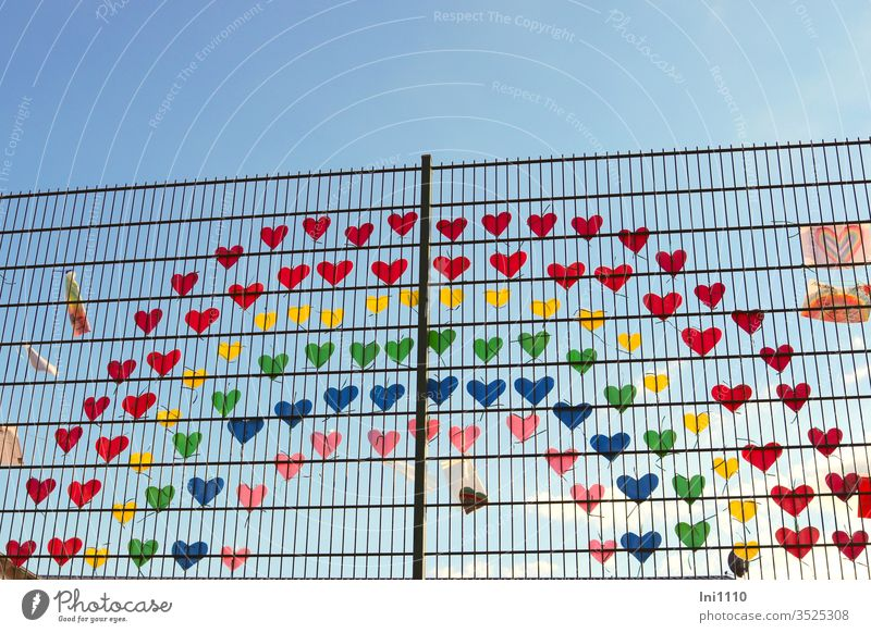 Rainbow on the fence made of many little colorful hearts as a sign of solidarity during Corona corona virus Solidarity Compassion Loneliness Attachment