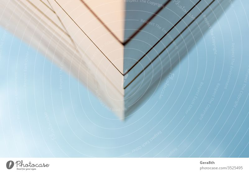 close up wall of a modern building against a blue sky abstraction angle architecture backdrop background blur blurred business city color connection