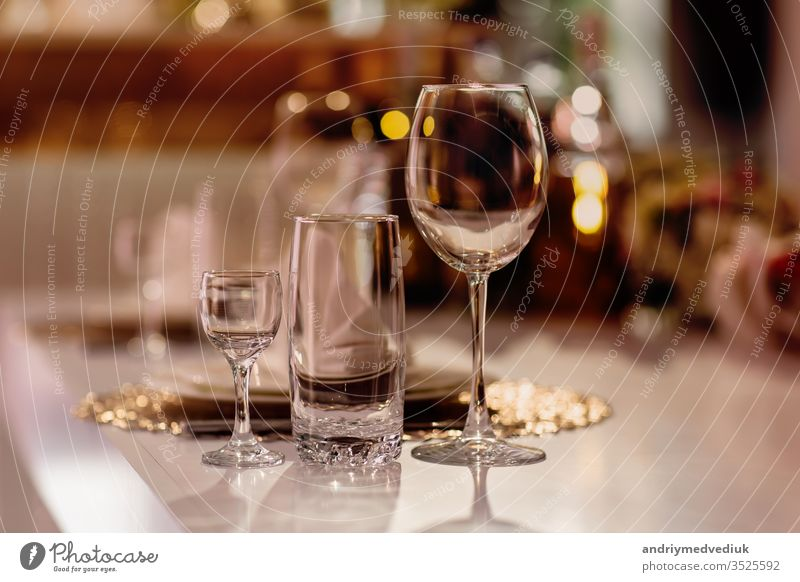 Serving on the table. Crystal glasses. Wedding. Banquet. banquet decoration restaurant cafe cutlery dining dinner drink elegant interior lunch luxury napkin