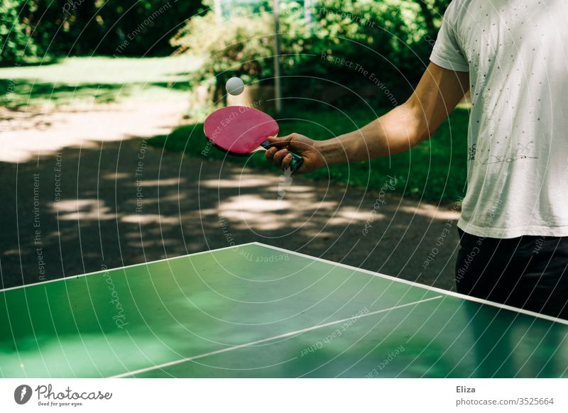 Man playing table tennis outside Table tennis Table tennis table Playing Table tennis bat racket Sports Leisure and hobbies Exterior shot Table tennis ball