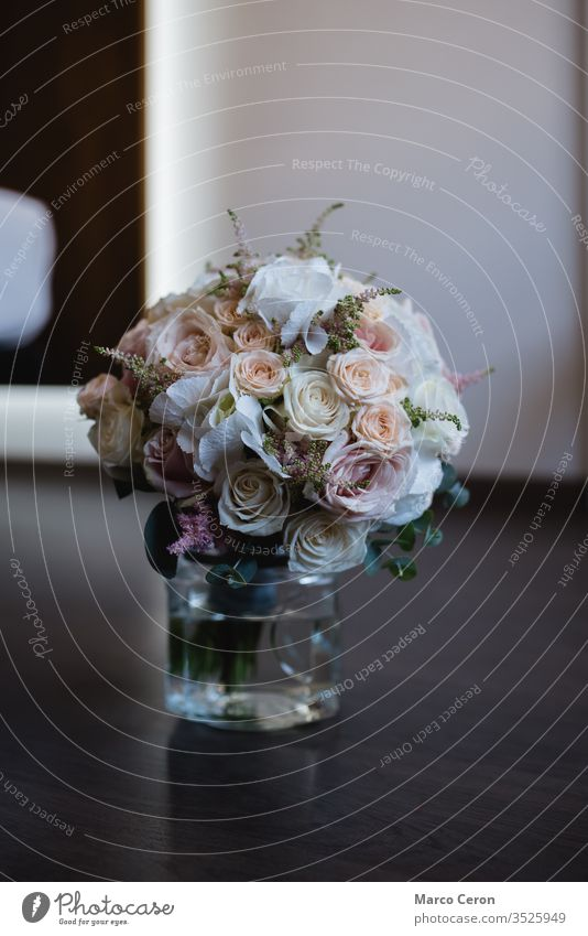Close up of beautiful bridal roses bouquet in a vase with water on the floor bridal bouquet wonderful flower wedding bouquet decoration bride florist beauty