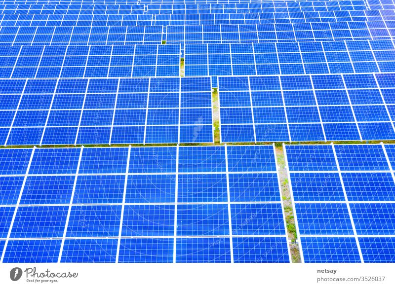 power solar panel on blue sky background,alternative clean green energy concept. Aerial view of Solar panels Photovoltaic systems industrial landscape light