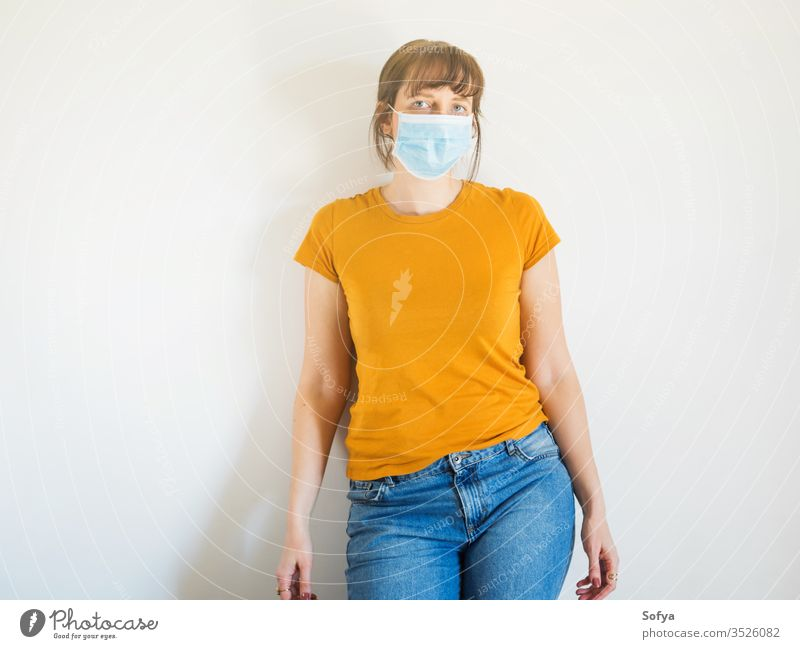 Young woman wearing protective face mask covid19 coronavirus quarantine stay home alone protection isolation epidemic flu girl pollution prevention spreading