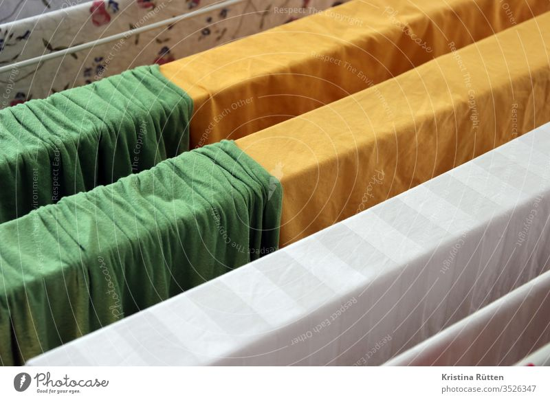 bed linen hangs to dry on the clothes horse Bedclothes Sheet Sheets Laundry Dry Cotheshorse Washing day neat Fresh variegated colored green Yellow White Cloth