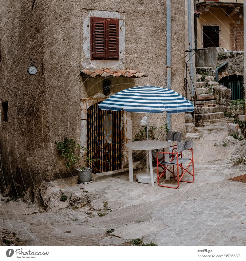 Backyard in front of stone house with parasol and chairs Croatia Europe Summer Summer vacation rear building idyllic backyard Camping Camping chair Sunshade