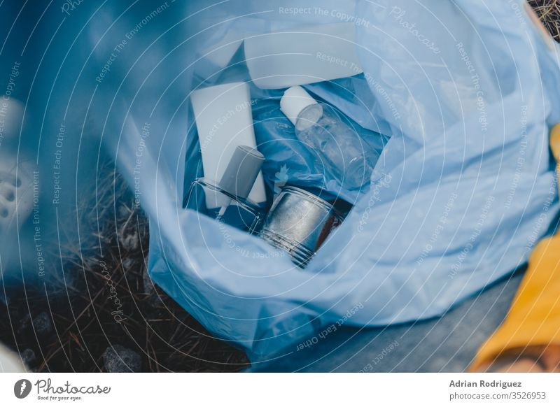 High angle shot of a plastic garbage bag with recyclable bottles - environmental pollution concept trash waste rubbish ecology recycling recycle dump background