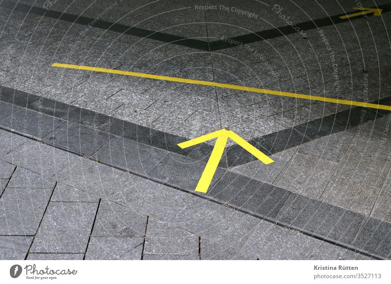 yellow arrows on the floor as distance and direction markers Arrow Markings Adhesive tape Ground gap detachment distance mark spacer distance marking Schedule