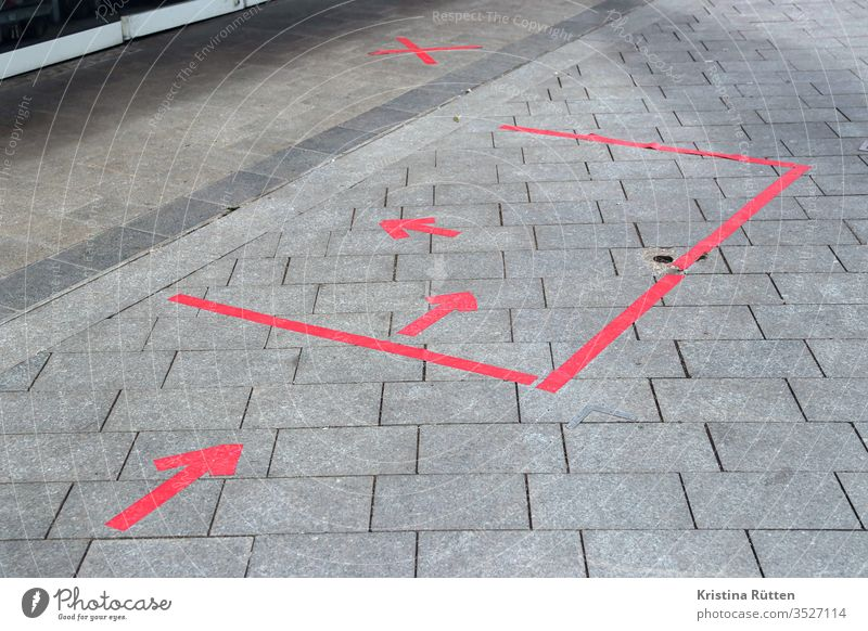 red tape arrows and markings on the floor Arrow Markings Adhesive tape Ground gap detachment distance mark spacer distance marking Schedule Highlight divide