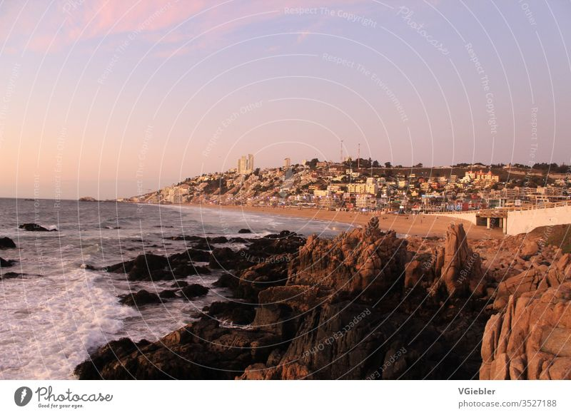 coast, in the foreground rocks in the background houses, white water, beach seascape Picturesque Sea coast bank Water travel Calm Town Tourism Ocean Blue Bay