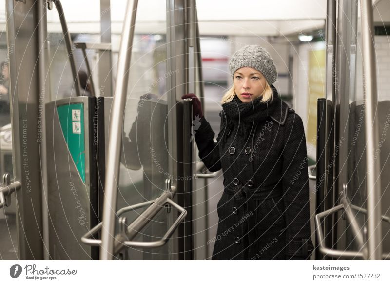 Woman on subway. woman transport public transportation underground metro train urban young travel daily routine ticket pass exit entrance person female city