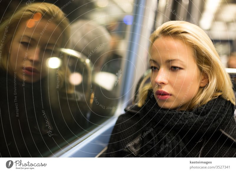 Woman looking out metro's window. transport portrait woman tube subway transpotation travel female urban view observe thoughtful trip sitting solitude interior