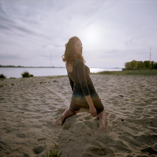 analogue backside portrait of a young woman in a dress on the beach at sunset Woman girl already great Athletic Slim fit brunette Curl long hair Concrete Sand