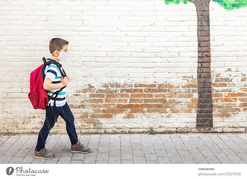 Little boy going to school with protective mask back to school backpack care child childhood city class closed college corona corona virus coronavirus covid-19