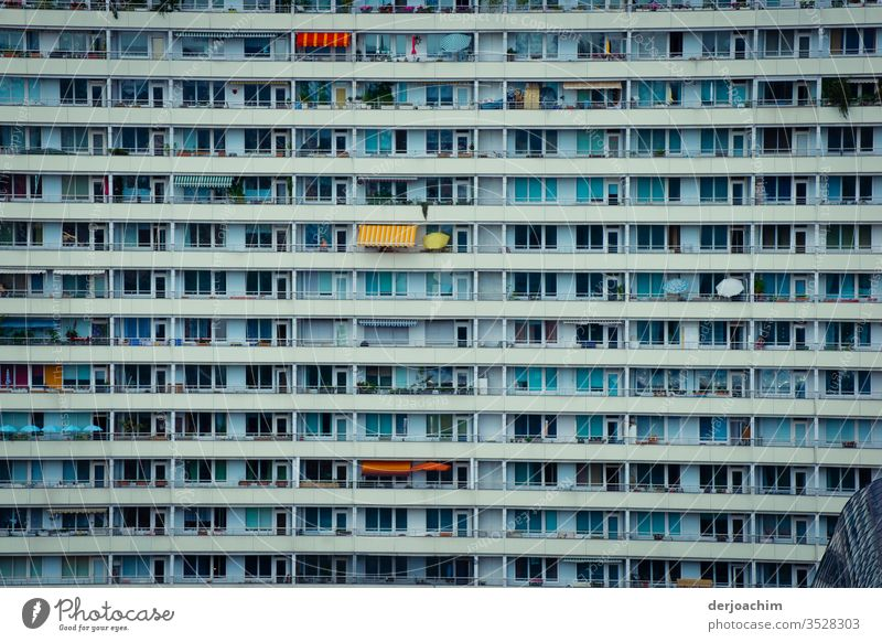 """""""In the middle of Berlin """" Plattenbau facade with many windows and balconies. There are also a few parasols High-rise Facade Window Architecture built"""