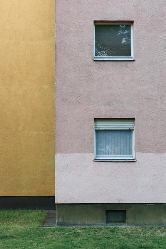 Façade and two windows of a residential house of the 60s, ochre yellow and pink in geometric representation Facade Window 1960s Apartment Building Curtain