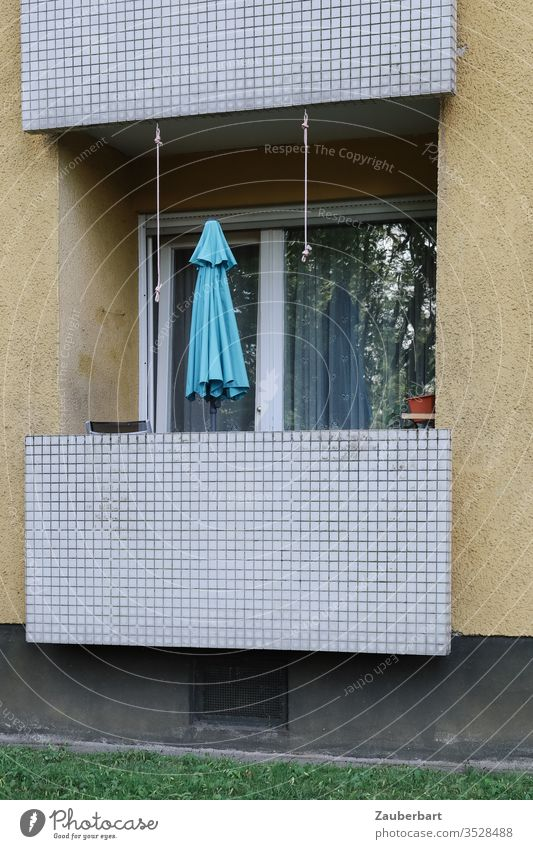Balcony of an apartment in a house of the 60s with light blue parasol Flat (apartment) Sunshade ground floor tiles Pattern Yellow at home Modest Window