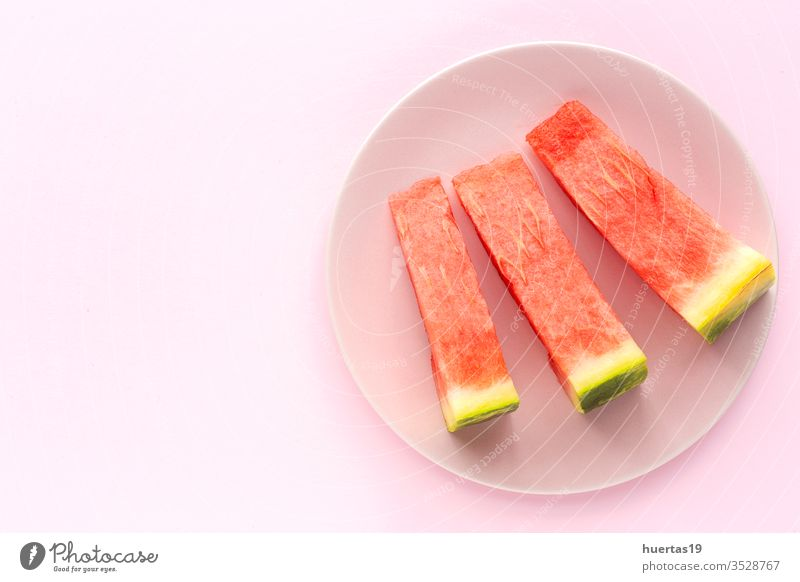 Fresh watermelon on pink background from above fruit summer fresh diet refreshment food healthy sweet cold green ripe vitamin freshness nutrition slice flat lay