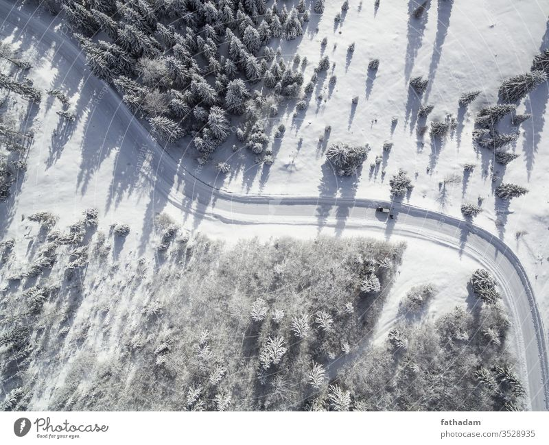 Winter road in forest aerial view Aerial photograph Bird's-eye view Car Driving Ice Frost Snow Weather Forest Tree Landscape Wide angle Curve Vacation & Travel