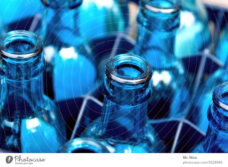empties Neck of a bottle Blue Transparent Glass Blue tone Containers and vessels Glassbottle Multiple cake Mineral water water tank empty Beverage Cold drink