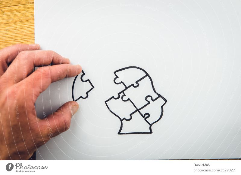 Assistance - Putting the head / brain together assistance Puzzle Head Human being Man by hand do a jigsaw puzzle Composition of the put together solution ponder