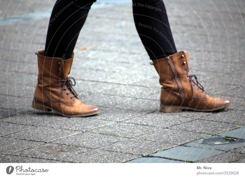 On the road in the city Going High heels Woman Legs Footwear Street Leather shoes Boots Brown Feminine Lifestyle laced shoelaces Zipper Paving stone Sidewalk