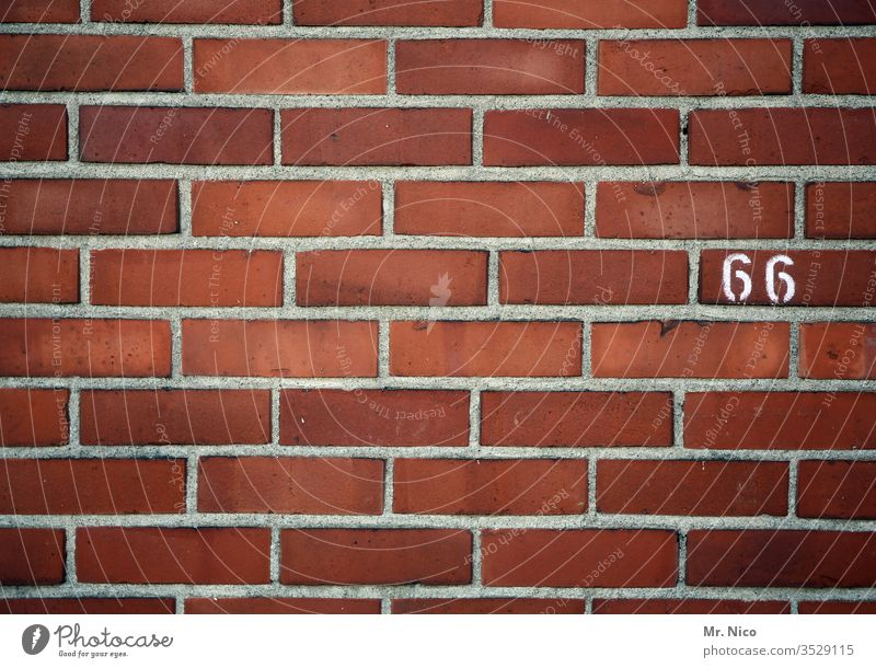 66 House number Digits and numbers Sign Wall (barrier) Wall (building) sixty-six Brick wall brick wall Red mark lines oldstyle Orientation Information