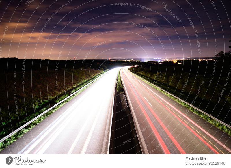 Tracers on motorway Strip of light raiser Floodlight Car headlights Night sky Single-minded Speed rush Illuminate Bright Colours Night shot Target Stress Haste