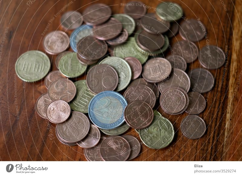 A pile of coins on a wooden table Money Coins Euro finance small change Save Money box cash box gratuity Business Paying Loose change Cent Colour photo savings