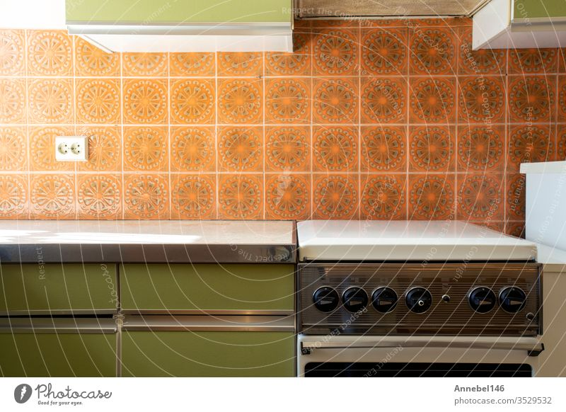 Vintage retro kitchen with orange pattern tiles, american retro kitchen home interior design 70's style vintage old room table furniture cooking architecture