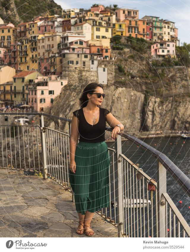 Beautiful woman viewing sunset in Italy stone italy houses colors breathing travel young girl style people wall local person female lifestyle cute beautiful