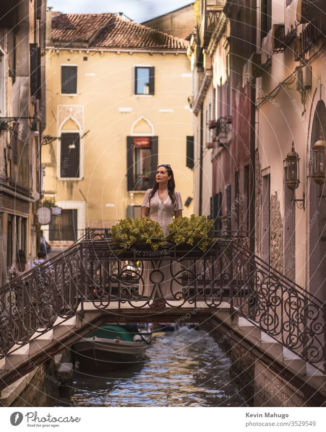 Beautiful woman looking at the canals of Venice, Italy Woman Stone houses colors respiration travel youthful girl Style people Wall (building) Tavern person