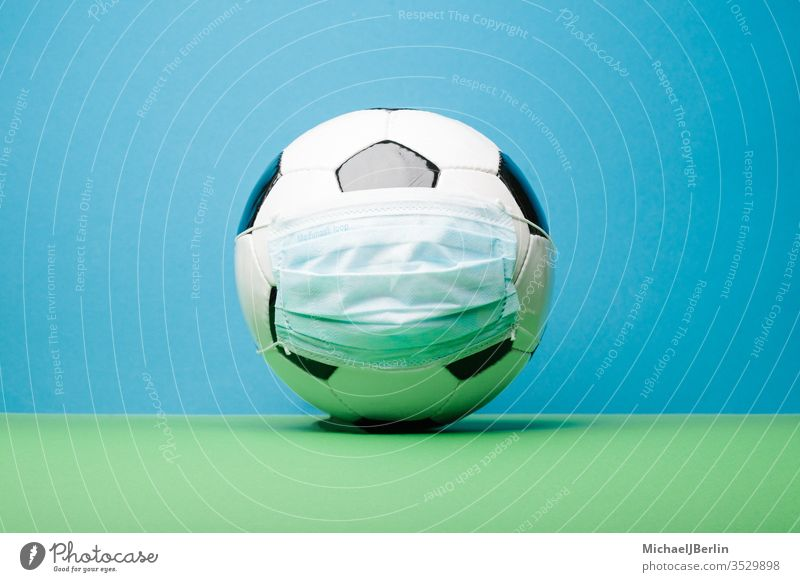 Football with corona mouth nose protection mask soccer Ball Sports covid-19 covid19 loosening League National league restart Ghost Games hygiene concept