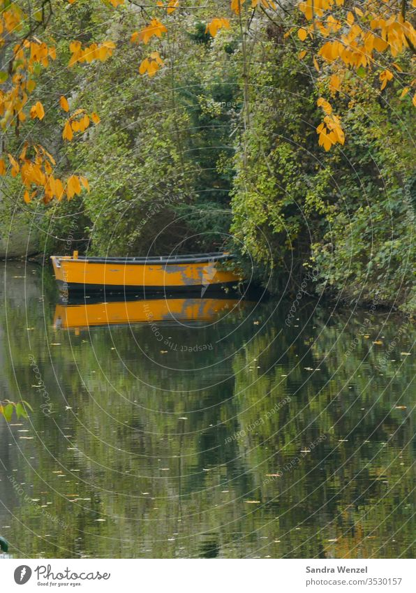 Autumn day with boat October Rowboat Lake Pond Body of water Fishing (Angle) Autumn leaves autumn Yellow reflection wooden boat