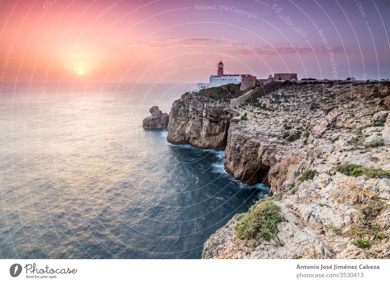 View of the lighthouse and cliffs at Cape St. Vincent at sunset. Continental Europe's most South-western point, Sagres, Algarve, Portugal. algarve architecture