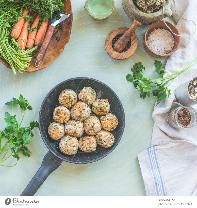 Delicious fried buckwheat balls in frying pan on kitchen table. View from above. Vegan food. Home cuisine delicious background seasonings herbs concept healthy