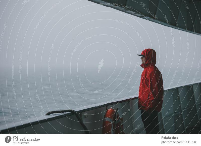 #AS# crossing Red Jacket Ferry Crossing Life belt Navigation ferry trip Disperse Ocean seascape hazy Fog Boating trip rehling Observe Man Young man Eyeglasses