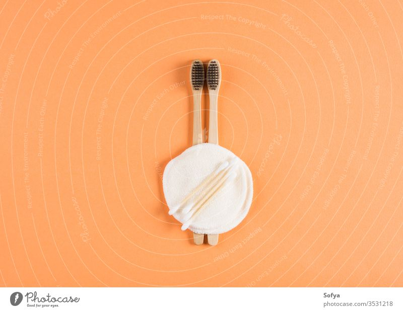 Zero waste beauty concept with toothbrushes zero waste background lifestyle bamboo natural nature orange organic products recycle hygiene set summer wellness