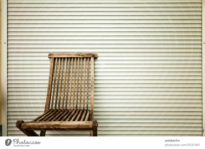 Garden chair in front of closed blind Venetian blinds Chair Folding chair Furniture Free Empty Relaxation holidays allotment Garden allotments Deserted