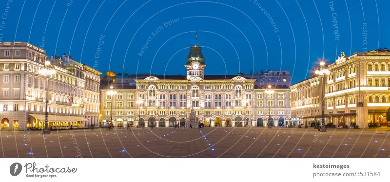 The City Hall, Palazzo del Municipio, is the dominating building on Trieste's main square Piazza dell Unita d Italia. Trieste, Italy, Europe. Illuminated city square shot at dusk.