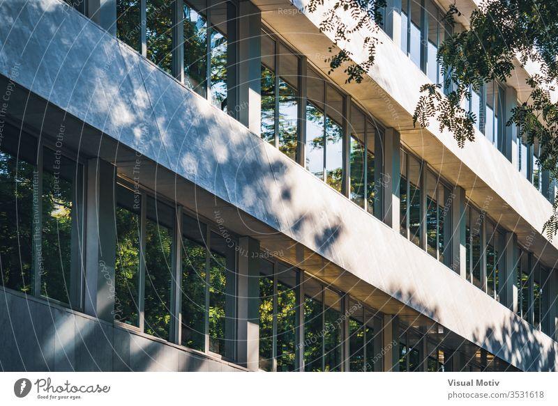 Facade of an 80's office building under the noon light facade color outdoor outdoors exterior sunlight architecture architectural architectonic reflection