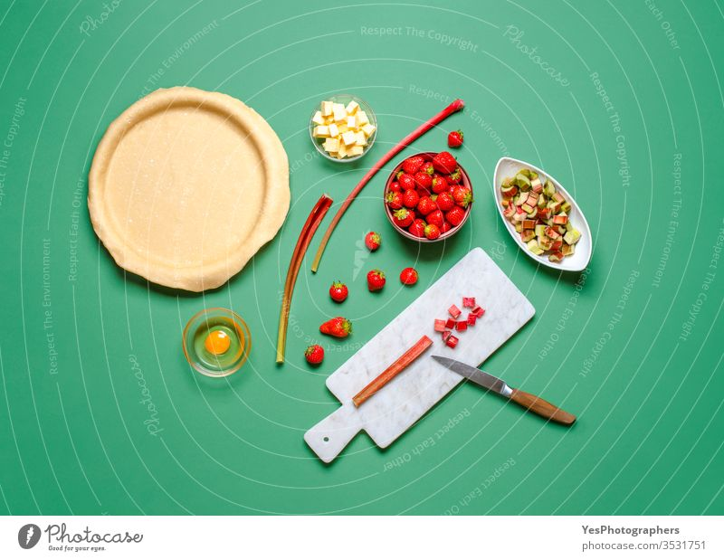 Making a pie at home. Strawberries and rhubarb pie ingredients above view bake bakery baking butter cake chopping crust cuisine delicious dessert dough flat lay