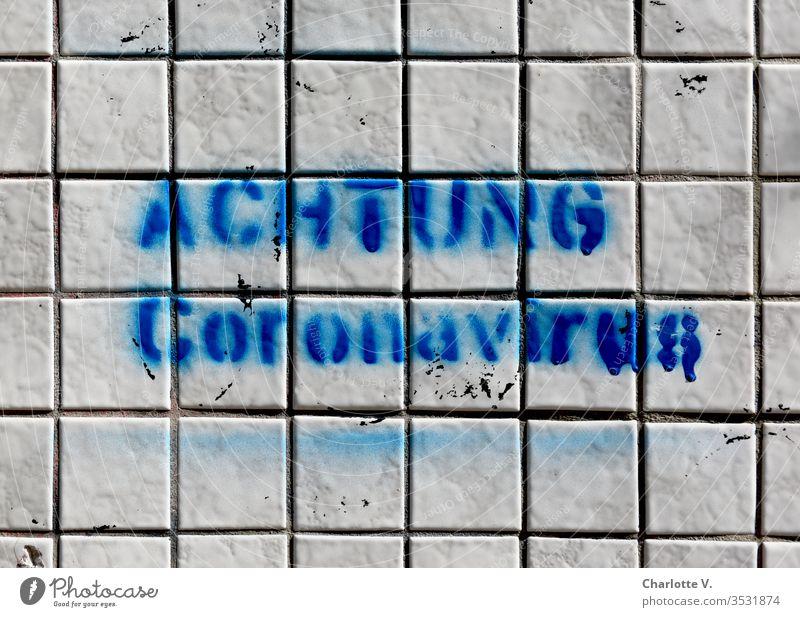 corona thoughts | attention Coronavirus! Blue writing on white tiles. coronavirus corona crisis coronavirus SARS-CoV-2 Graffiti Characters leap White Trashy