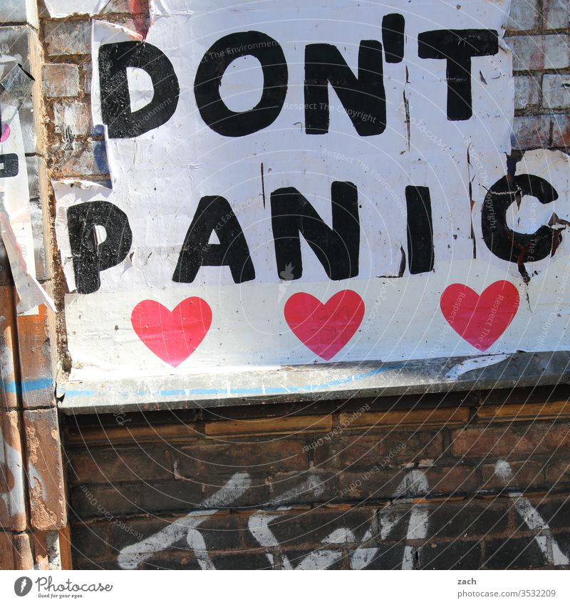 Facade with the inscription Don't Panic Wall (barrier) Wall (building) Stone Brick Structures and shapes Red Old Graffiti Art Decline Stencil Broken Transience