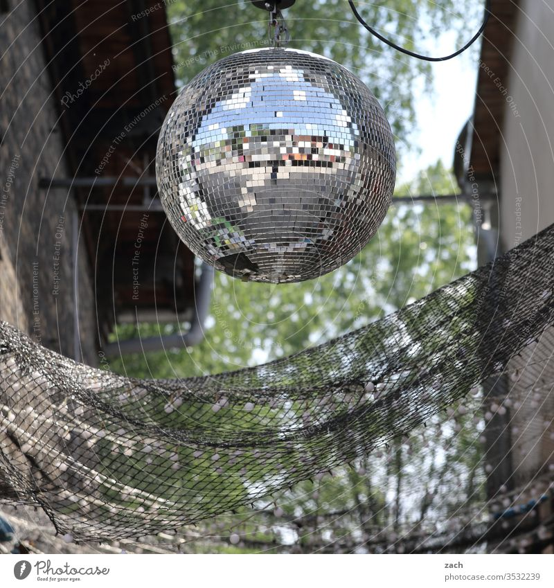 disco ball hangs in the garden Party Disco Disco ball Disc jockey Party night Outdoor festival Club Feasts & Celebrations Music Lifestyle Dance Light Night life