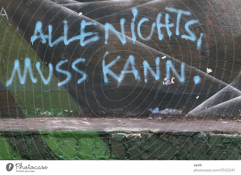 "Facade with graffiti and the inscription ""Alles nichts, muss kann Graffiti Wall (building) Sign Characters Wall (barrier) Gray built Fire wall Berlin street art"