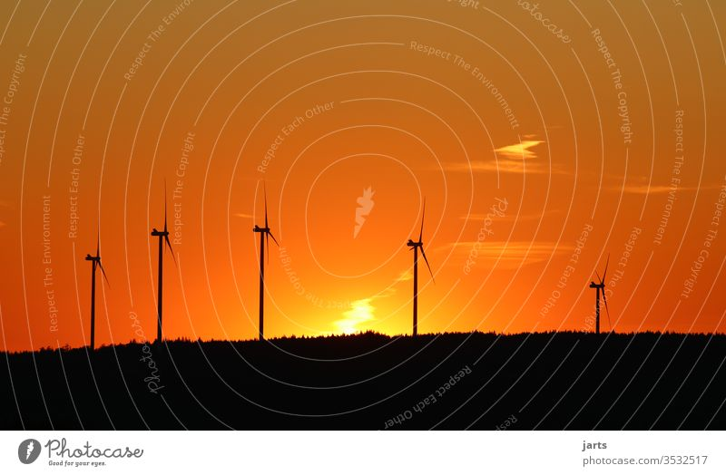 Wind turbines at sunset Wind energy plant Renewable energy Energy Energy industry Pinwheel Sky Environment Environmental protection Colour photo Exterior shot
